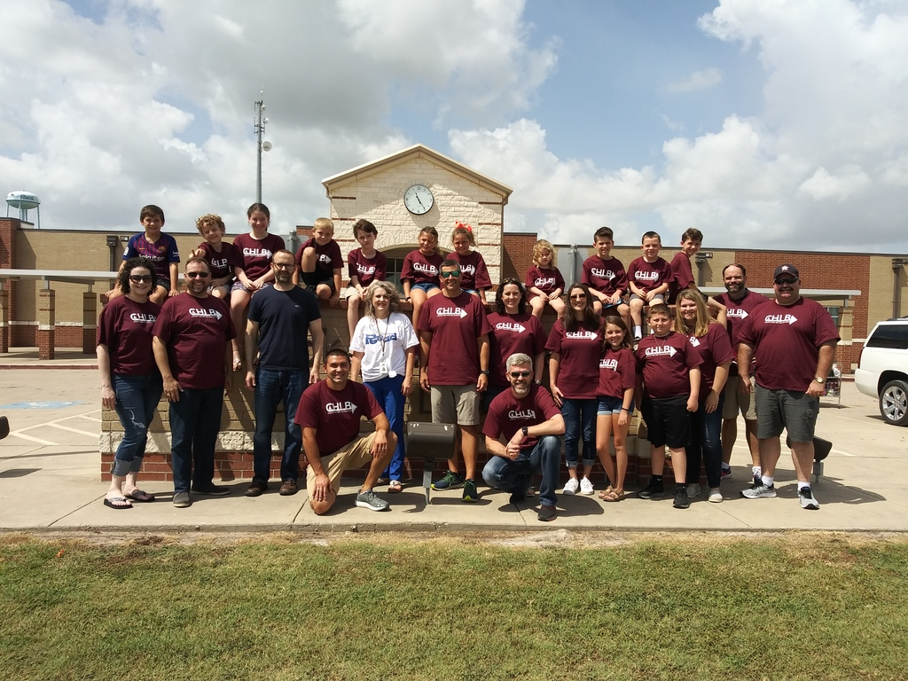 Group photo of all of the people from Christ United Methodist Church whom help out front of Snook ISD school Building