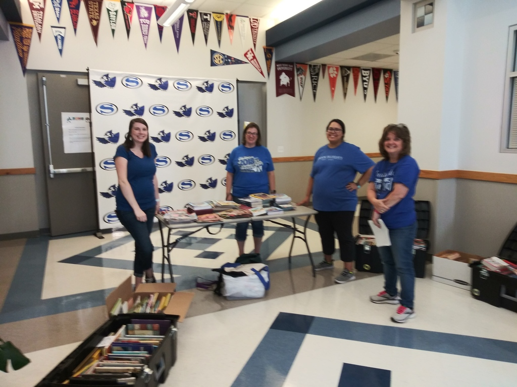 Four of the elementary teachers who helped with bluejays read.
