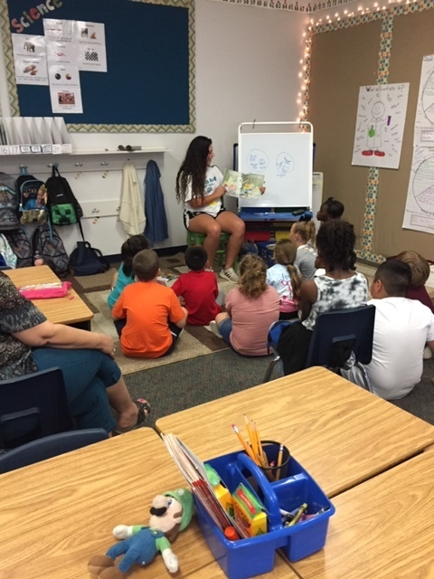 Aggie Athletes sharing the love to read with Second-graders.