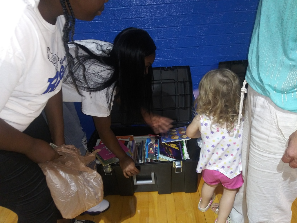 Volleyball Player picking books with a kid