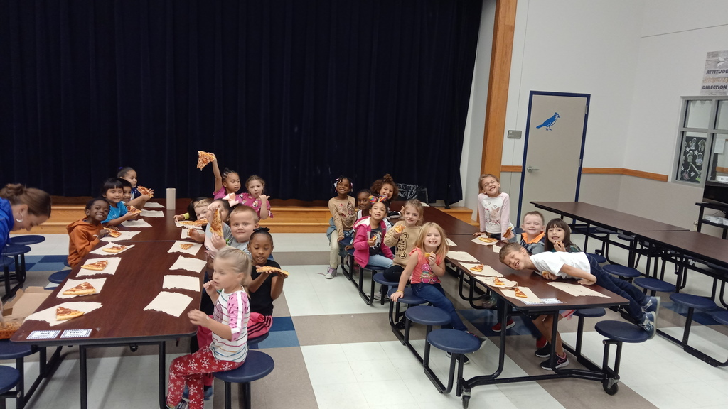 Kids eating pizza at a pizza part for perfect attendance the first six-weeks of school. 1