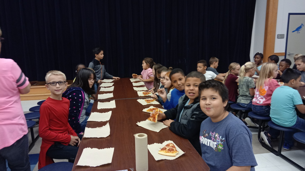 Kids eating pizza at a pizza part for perfect attendance the first six-weeks of school. 2