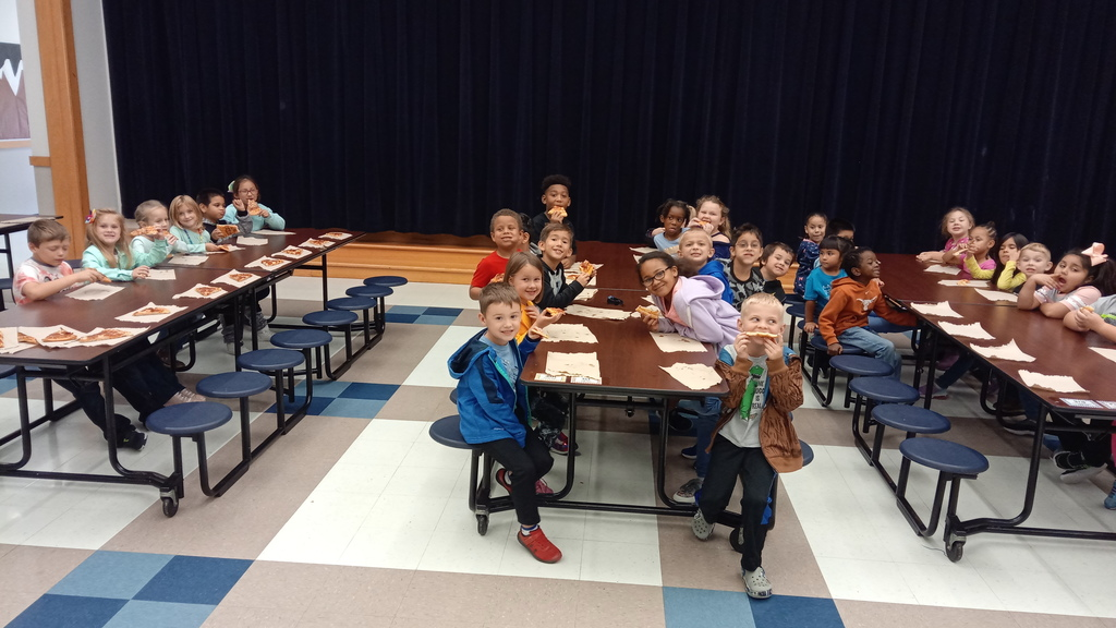 Kids eating pizza at a pizza part for perfect attendance the first six-weeks of school. 3