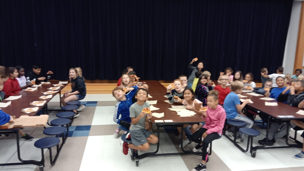 Kids eating pizza at a pizza part for perfect attendance the first six-weeks of school. 7