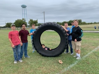 kids playing with a big tire