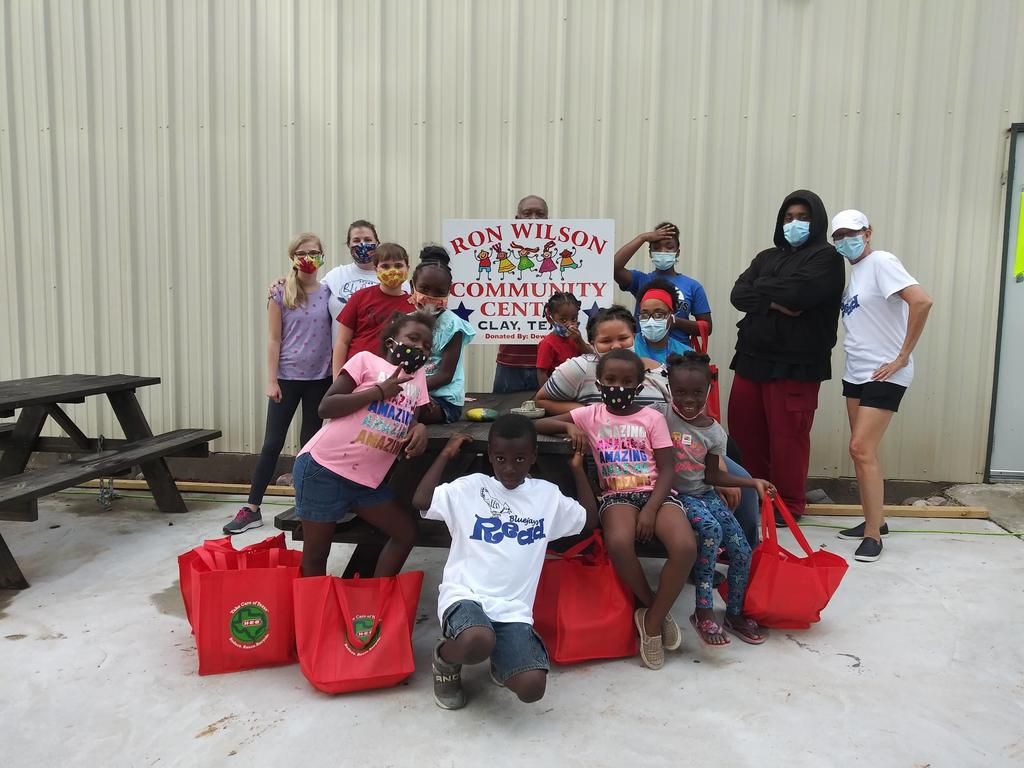 Bluejays Read in Clay even during a pandemic. Children were able to choose books at the recently opened REW Community Center in Clay. Every child left with a copy of Jabari Jumps by Gaia Cornwal or Bronx Masquerade by Nikki Grimes
